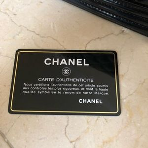 Black Chanel Boy Bag with gold shoulder chain